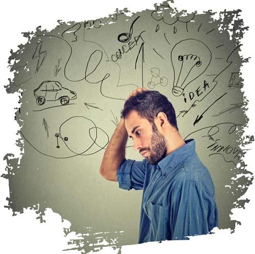 ein Mann fasst sich an den Kopf weil er sich so schwer tut eine Entscheidung zu treffen